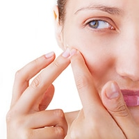 How to hide a pimple on your face?